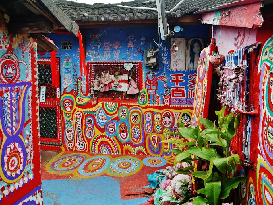 <p>A tiny section within the Nantun District of Taichung, the Rainbow Village first began as a military dependents' village before Huang Yung-Fu transformed the area into a vibrant display of street art. In the early 2000s, real estate developers began making plans to demolish the old buildings, but Huang did not want to leave his home. He soon began painting his house with colorful, comic-like figures and animals in protest. Soon after, local university students discovered his work and campaigned to save the village.</p><p> In October 2010, the mayor of Taichung officially named the Rainbow Village as a cultural area, saving it from destruction. Today, Huang is known as the Grandpa Rainbow by the countless visitors who come to revel in his work.</p>