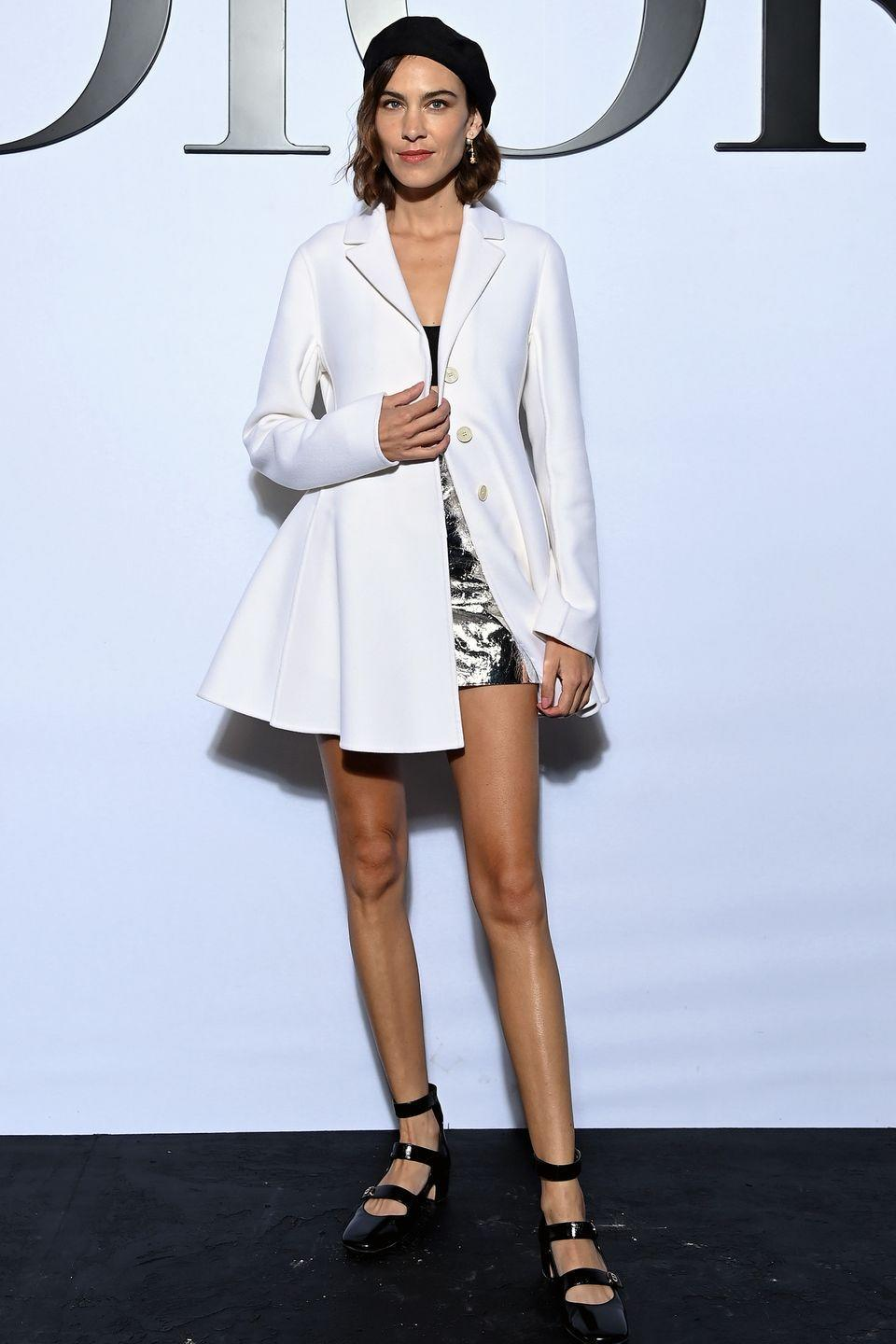 <p><strong>28 September </strong></p><p>Alexa Chung teamed her metallic mini with a black beret and a chic white coat. </p>