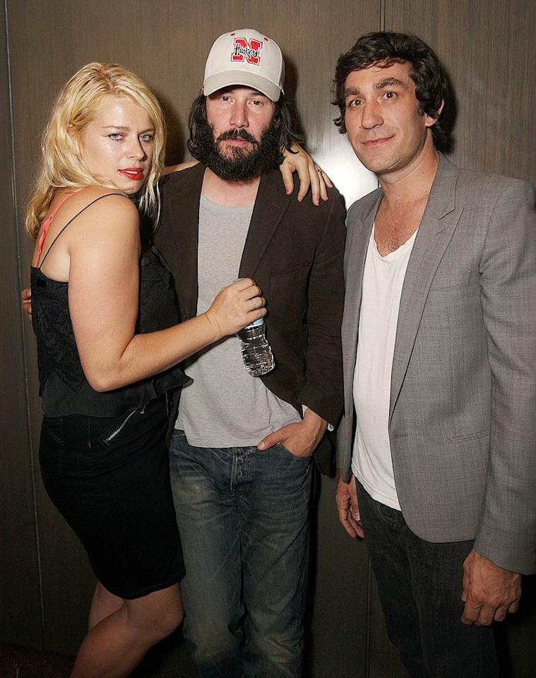 """A scruffy Keanu Reeves (with John Taylor's ex-wife Amanda de Cadenet) also came out to support Bolthouse, whose """"Adult Playground"""" infused art, music, and cocktails. Let's hope that Keanu's facial hair is for an upcoming role! Chris Weeks/<a href=""""http://www.wireimage.com"""" target=""""new"""">WireImage.com</a> - August 12, 2009"""