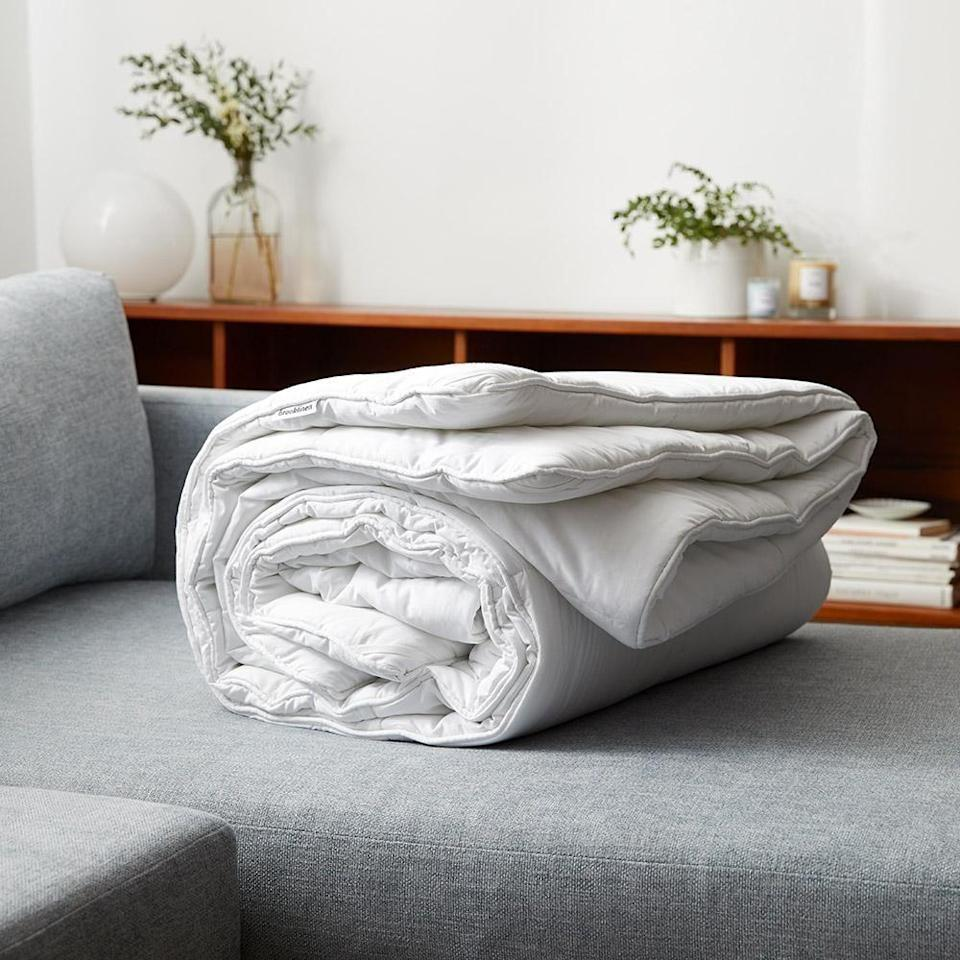 """<p><strong>Brooklinen</strong></p><p>brooklinen.com</p><p><a href=""""https://go.redirectingat.com?id=74968X1596630&url=https%3A%2F%2Fwww.brooklinen.com%2Fproducts%2Fweighted-comforter&sref=https%3A%2F%2Fwww.housebeautiful.com%2Fshopping%2Fbest-stores%2Fg35154173%2Fbrooklinen-surprise-sale-january-2021%2F"""" rel=""""nofollow noopener"""" target=""""_blank"""" data-ylk=""""slk:Shop Now"""" class=""""link rapid-noclick-resp"""">Shop Now</a></p><p><strong><del>$249</del> $211.65 (15% off)</strong></p><p>It's no secret that the past few months have been <em>very </em>stressful. Brooklinen's weighted blanket has a soothing effect that feels like a big hug.</p>"""