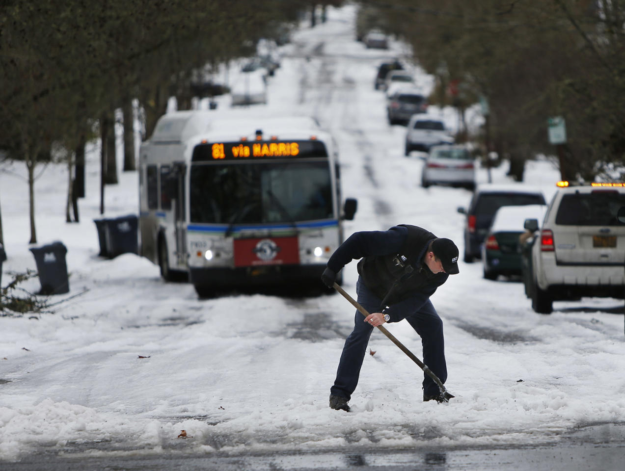 <p>An LTD field supervisor works to get a bus moving after it became stuck near Harris Street in Eugene. Ore. Monday Jan. 9. 2017. Many roads remained snow and ice-covered from weekend storms despite above freezing temperatures. (Andy Nelson/The Register-Guard via AP) </p>