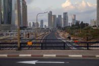 A highway is empty from cars following new restrictions in the three-week nationwide lockdown, in Tel Aviv, Israel, Saturday, Sept. 26, 2020. (AP Photo/Oded Balilty)