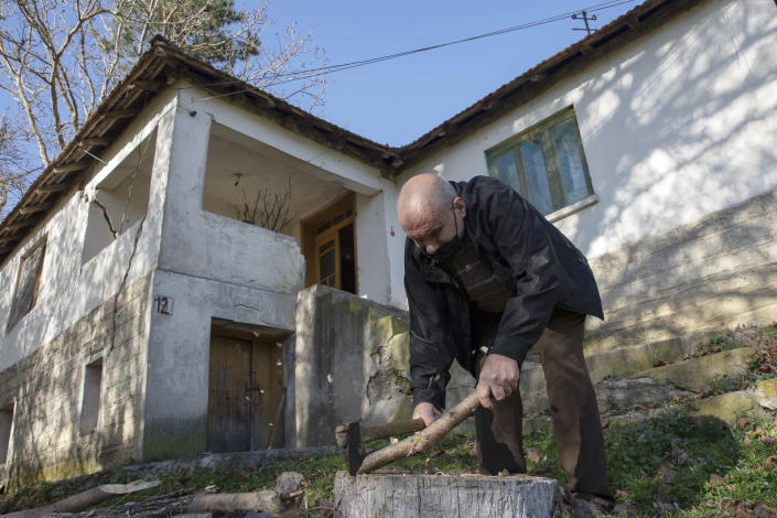 "Kosovo Albanian Fadil Rama chops fire wood for a Kosovo Serb Blagica Dicic a lonely 92-year old woman in a remote village of Vaganesh, Kosovo on Thursday, Nov. 19, 2020, abandoned by all her former ethnic Serb neighbors. Neighbor Blagica Dicic, is 92 and in failing health, in the remote ethnic Serb minority village in the mountains of eastern Kosovo but Fadil Rama comes from the other side of Kosovo's bitter ethnic divide, being a member of Kosovo's ethnic Albanian majority and Rama said he saw nothing strange in helping an elderly Serb. ""I will never leave her on her own,"" he said. (AP Photo/Visar Kryeziu)"