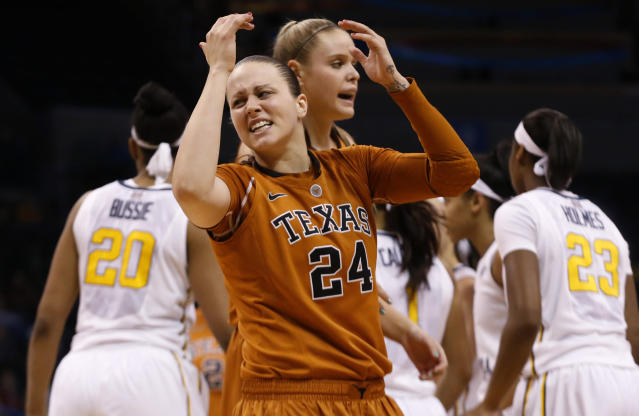 Texas guard Chassidy Fussell (24) reacts to fouling out in the second half of an NCAA college basketball game against West Virginia in the semifinals of the Big 12 Conference women's tournament in Oklahoma City, Sunday, March 9, 2014. West Virginia won 67-60. (AP Photo/Sue Ogrocki)