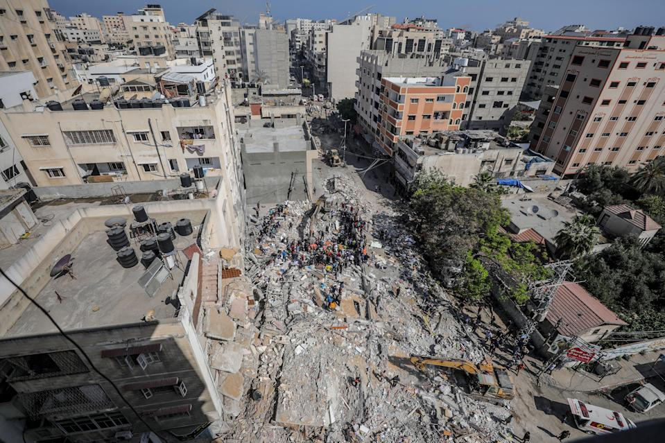 Palestinian civil defence search for survivors in the rubble of a destroyed house after an Israeli air strike in Gaza CityEPA