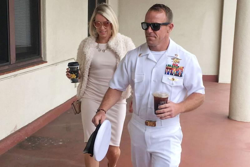 Navy Special Operations Chief Edward Gallagher, right, walks with his wife, Andrea Gallagher, left, as they arrive to military court in June. | Julie Watson/AP/Shutterstock