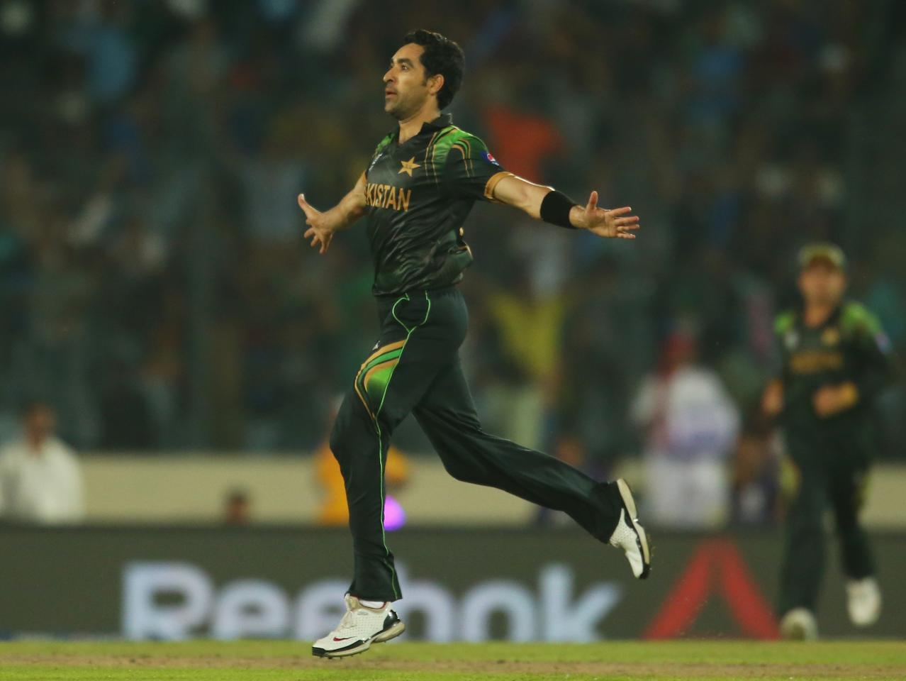 DHAKA, BANGLADESH - MARCH 23:  Umar Gul of Pakistan celebrates after dismissing Nathan Coulter-Nile of Australia during the ICC World Twenty20 Bangladesh 2014 match between Australia and Pakistan at Sher-e-Bangla Mirpur Stadium on March 23, 2014 in Dhaka, Bangladesh.  (Photo by Scott Barbour/Getty Images)