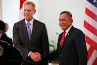 U.S. Defense Secretary Patrick Shanahan shakes hands with his Indonesian counterpart Ryamizard Ryacudu (R) during a press briefing after their meeting in Jakarta