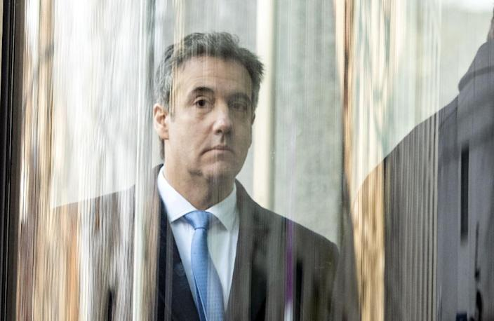 """Federal prosecutors say the president's former personal lawyer Michael Cohen """"acted in coordination with and at the direction of"""" Donald Trump in making hush payments to two women in violation of campaign finance laws in 2016 (AFP Photo/COREY SIPKIN)"""