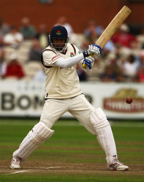 MANCHESTER, ENGLAND - AUGUST 12:  VVS Laxman of Lancashire edges the ball towards the boundary during the LV County Championship Division One match between Lancashire and Durham at Old Trafford on August 12, 2009 in Manchester, England.  (Photo by Matthew Lewis/Getty Images)