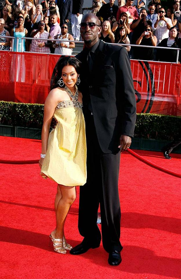 "Reigning NBA champ Kevin Garnett towered over his adorable wife Brandi, who looked yummy in yellow. Jeffrey Mayer/<a href=""http://www.wireimage.com"" target=""new"">WireImage.com</a> - July 16, 2008"