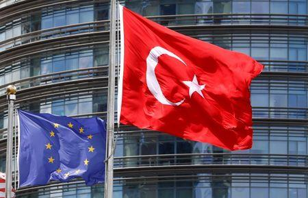 European Union and Turkish flags fly outside a hotel in Istanbul