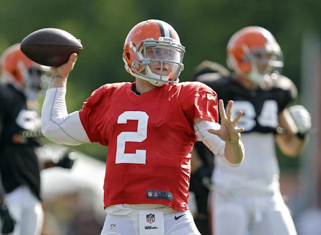 Cleveland Browns quarterback Johnny Manziel passes during practice at NFL football training camp in Berea, Ohio Friday, Aug. 15, 2014. (AP Photo/Mark Duncan)