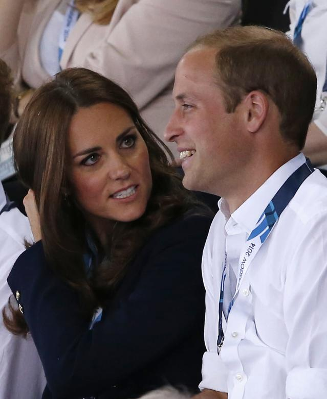Catherine (L), Duchess of Cambridge, sits with her husband Britain's Prince William as they watch artistic gymnastics at the 2014 Commonwealth Games in Glasgow, Scotland, July 28, 2014. REUTERS/Jim Young (BRITAIN - Tags: SPORT GYMNASTICS ROYALS)
