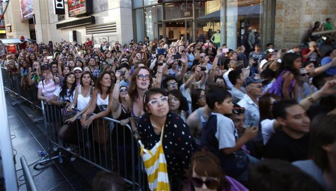 "Fans watch a performance by Katy Perry at the premiere of ""Katy Perry: Part of Me"" at the Grauman's Chinese theatre in Hollywood, California June 26, 2012."