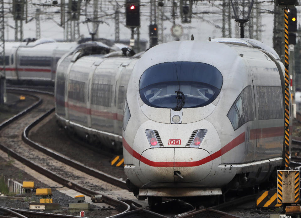 FILE - In this Wednesday, June 19, 2019 file photo, an ICE train approaches the main train station in Frankfurt, Germany. Germany's upper house of parliament has approved a plan to lower the value-added tax on train tickets, making rail travel cheaper from Jan. 1, 2020. (AP Photo/Michael Probst, file)