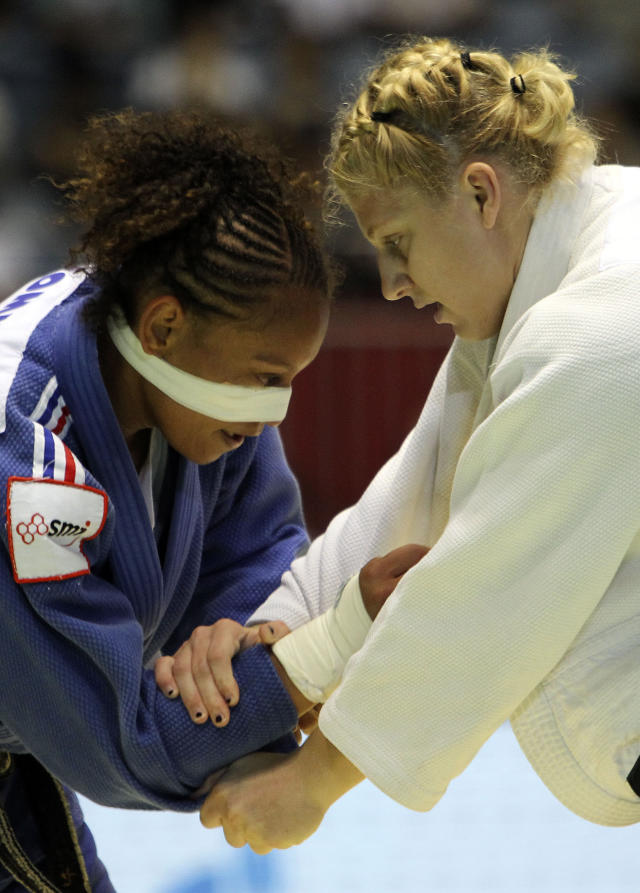 France's judoka Celine Lebrun, left, fights against Kayla Harrison of Wakefield, Mass. of the United States during the women's -78 kilogram category of the World Judo Championships in Tokyo Thursday, Sept. 9, 2010. (AP Photo/Junji Kurokawa)