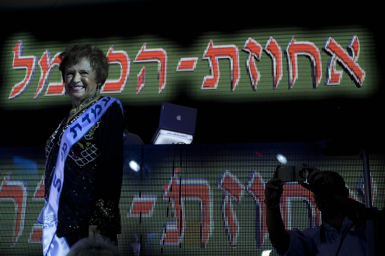 "Mania Herman, a Holocaust survivor participates in a beauty pageant, in the northern Israeli city of Haifa, Thursday, June 28, 2012. Fourteen women who lived through the horrors of World War II paraded on stage Thursday night in an unusual pageant, vying for the honor of being Israel's first ""Miss Holocaust Survivor."" (AP Photo/Sebastian Scheiner)"