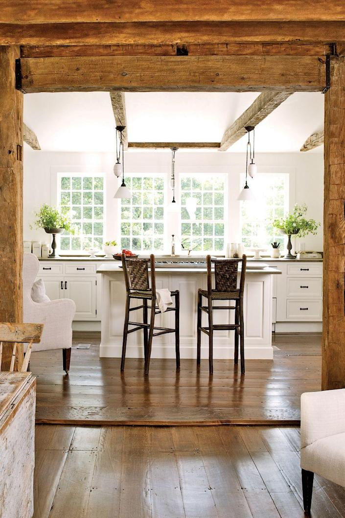 <p>When this homeowner ripped out the dropped ceilings and stripped plaster and lathe down, handsome posts and beams were exposed, lending a rusticity that's almost impossible to replicate.</p>