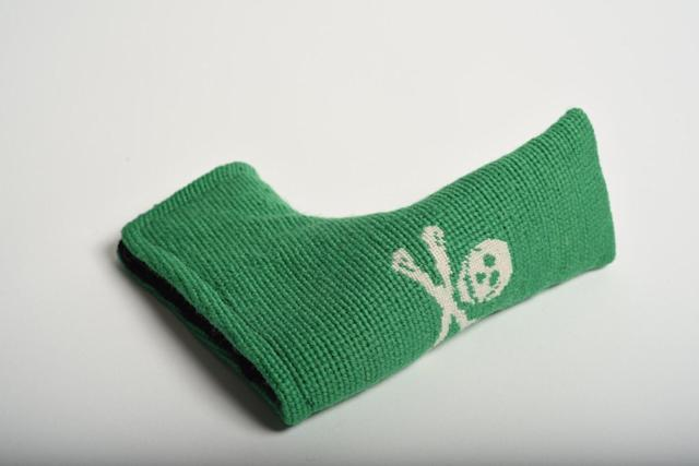"<p>Add some life to dad's putter with this unique needlepoint cover. It's handmade and lined with velvet to ensure a long life for both the cover and the club.</p> <p><a href=""https://needlegolf.com/collections/needlepoint-headcovers/products/jolly-roger-kelly-green-needlepoint-putter-headcover"" rel=""nofollow noopener"" target=""_blank"" data-ylk=""slk:needlegolf.com"" class=""link rapid-noclick-resp"">needlegolf.com</a>/$100</p>"