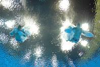 LONDON, ENGLAND - AUGUST 01: (L-R) Evgeny Kuznetsov and Ilya Zakharov of Russia compete in the Men's Synchronised 3m Springboard Diving on Day 5 of the London 2012 Olympic Games at the Aquatics Centre on August 1, 2012 in London, England. (Photo by Clive Rose/Getty Images)