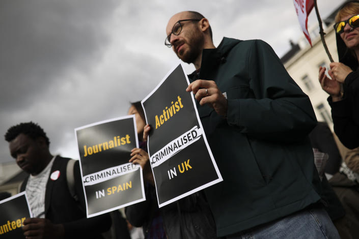 People hold posters during a protest outside the European Parliament in Brussels, Thursday, Oct. 3, 2019. Carola Rackete, the captain of a humanitarian rescue ship arrested for docking the vessel in an Italian port without authorization, is taking aim at the European Union for outsourcing the handling of migrants crossing the Mediterranean to conflict-ravaged Libya. (AP Photo/Francisco Seco)