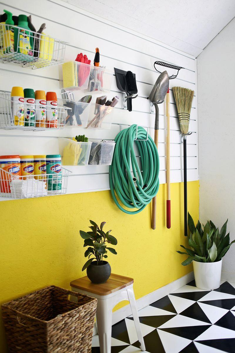 """<p>Kick clutter to the curb with a sturdy slatted wall panel that uses hooks, baskets, and more to hold necessities like cleaning and gardening supplies.</p><p><strong>Get the tutorial at <a href=""""https://abeautifulmess.com/workshop-space-organization/"""" rel=""""nofollow noopener"""" target=""""_blank"""" data-ylk=""""slk:A Beautiful Mess"""" class=""""link rapid-noclick-resp"""">A Beautiful Mess</a>.</strong></p><p><a class=""""link rapid-noclick-resp"""" href=""""https://www.amazon.com/Gladiator-GAWP042PBY-Wall-Storage-4/dp/B00GDO6UH4/ref=sr_1_3?tag=syn-yahoo-20&ascsubtag=%5Bartid%7C10050.g.36449426%5Bsrc%7Cyahoo-us"""" rel=""""nofollow noopener"""" target=""""_blank"""" data-ylk=""""slk:SHOP SLATTED WALL PANELS"""">SHOP SLATTED WALL PANELS</a></p>"""