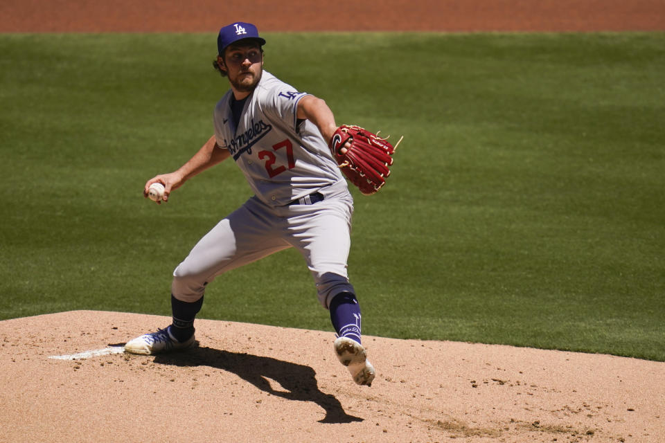 Los Angeles Dodgers starting pitcher Trevor Bauer works against a San Diego Padres batter during the first inning of a baseball game Sunday, April 18, 2021, in San Diego. (AP Photo/Gregory Bull)