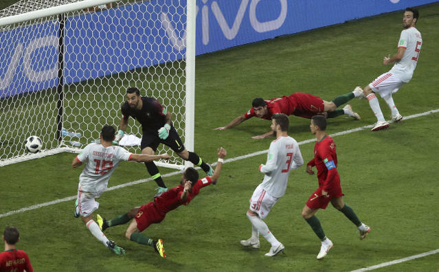 Spain's Diego Costa, left, scores his side's 2nd goal during the group B match between Portugal and Spain at the 2018 soccer World Cup in the Fisht Stadium in Sochi, Russia, Friday, June 15, 2018. (AP Photo/Thanassis Stavrakis)