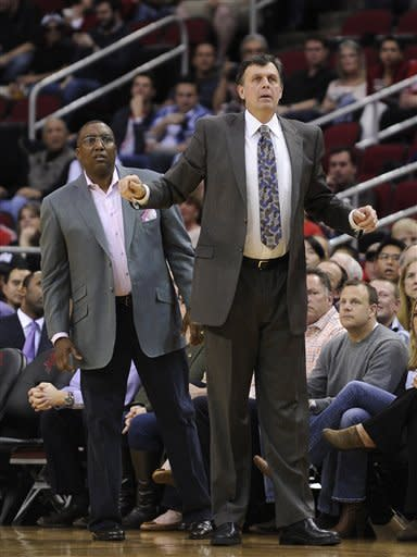 Houston Rockets coach Kevin McHale, right, and trainer Keith Jones look toward the action in the first half of an NBA basketball game against the Portland Trail Blazers, Friday, Feb. 8, 2013, in Houston. (AP Photo/Pat Sullivan)