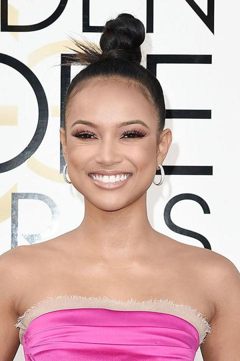 "<p>Perhaps one of the easiest summer hairstyles <em>ever</em><span>, a top knot like Karrueche's will keep your hair out of your face all day long. </span></p><p><span><strong>RELATED: <a rel=""nofollow"" href=""http://www.redbookmag.com/beauty/hair/g4127/pink-hair-for-grown-ups/"">9 Ways Grown-Ups Can Pull Off the Fun Pink Hair Trend</a></strong><span></span><br></span></p>"