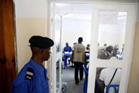 A Congolese policeman guards a room where officials of Congo's Independent National Electoral Commission (CENI) count presidential elections ballots at a tallying centre in Kinshasa, Democratic Republic of Congo, January 4, 2019. REUTERS/Baz Ratner