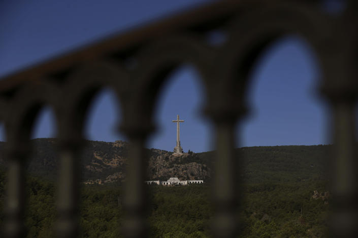 The Valley of the Fallen monument is seen at El Escorial Madrid, Friday, Aug. 24, 2018. Spain's center-left government has approved legal amendments that it says will ensure the remains of former dictator Gen. Francisco Franco can soon be dug up and removed from a controversial mausoleum. (AP Photo/Andrea Comas)