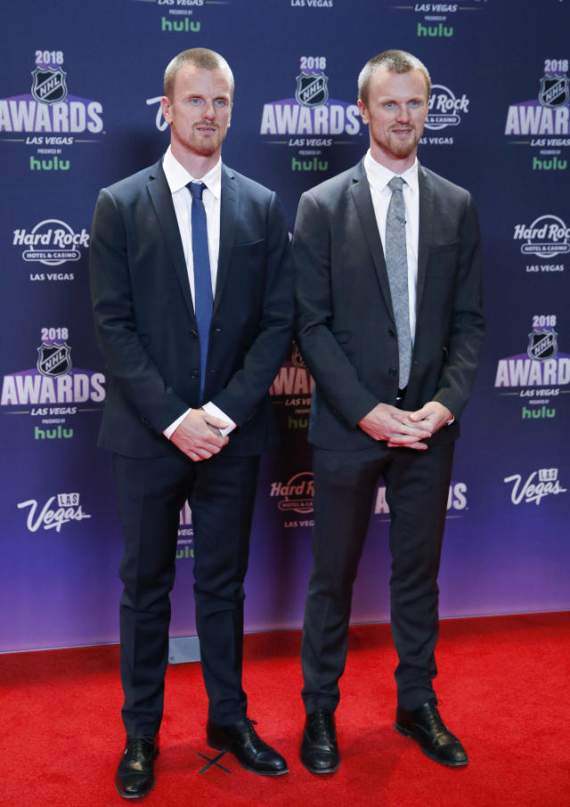 Daniel Sedin, left, and Henrik Sedin, former Vancouver Canucks who recently retired from the NHL, pose on the red carpet before the NHL Awards, Wednesday, June 20, 2018, in Las Vegas. (AP Photo/John Locher)