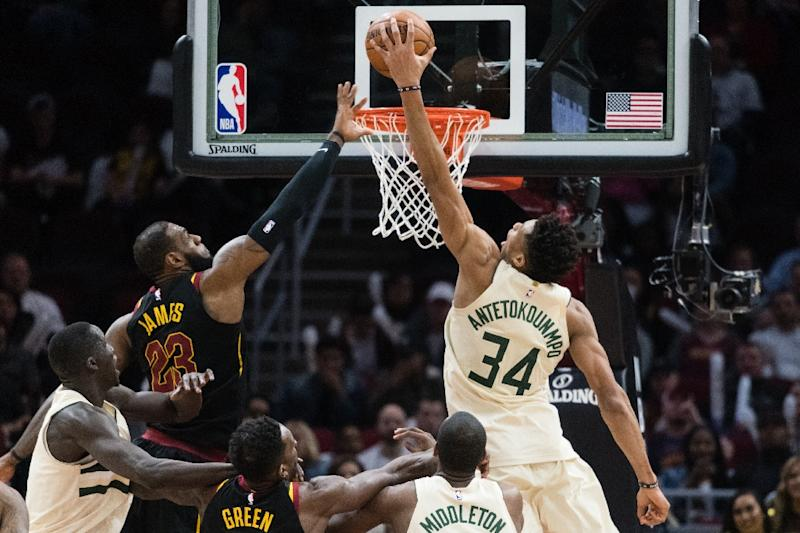 Giannis Antetokounmpo (R) led the Bucks, posting his 23rd 30-point game of the season with 37 points, 11 rebounds and five assists against the Cavaliers (AFP Photo/Jason Miller)