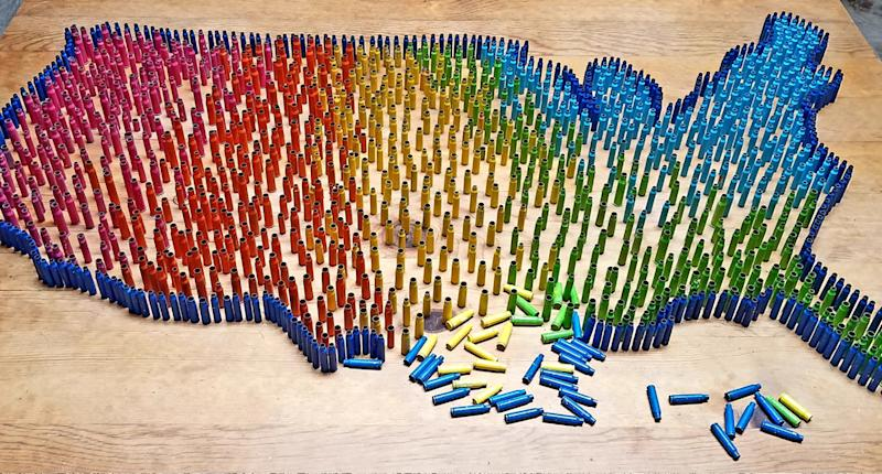 Artist Maureen Cain painted thousands of bullets in bright colors and placed them a sites of gun violence across the U.S. (Photo: Maureen Cain)