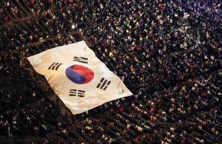 A giant sized South Korean national flag is carried over spectators during an event in support of Pyeongchang's bid to host the 2018 Winter Olympics