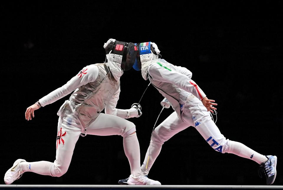<p>Hong Kong's Cheung Ka Long (left) compete against Italy's Daniele Garozzo on July 26 in the men's individual foil fencing gold medal bout.</p>