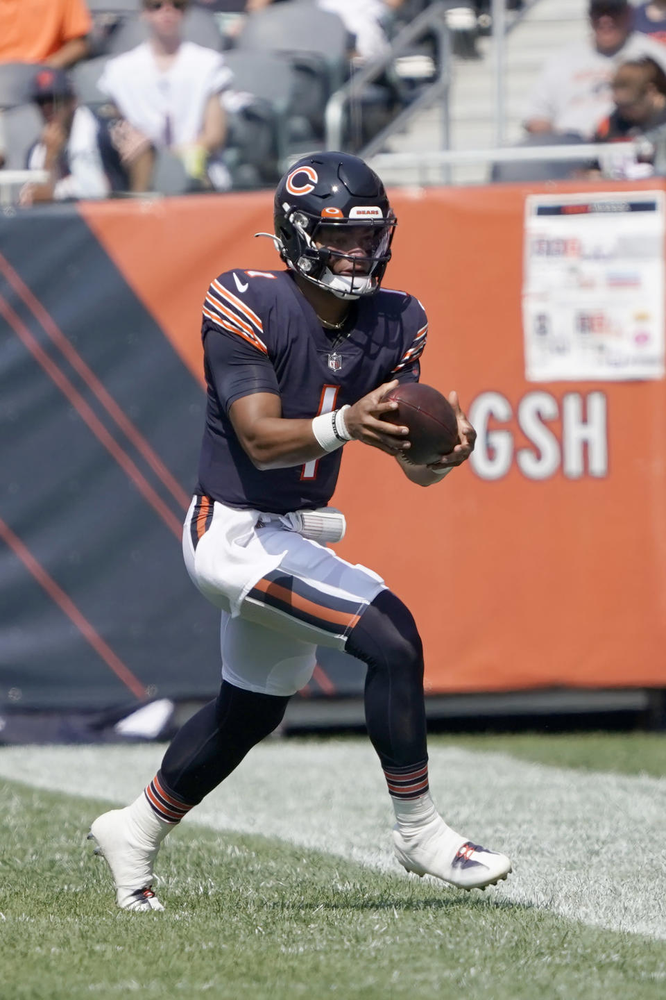 Chicago Bears quarterback Justin Fields carries the ball during the first half of an NFL football game against the Cincinnati Bengals Sunday, Sept. 19, 2021, in Chicago. (AP Photo/David Banks)