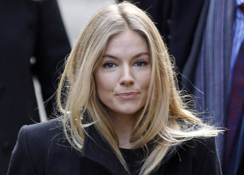 "FILE- This Thursday, Nov. 24, 2011 file photo shows British actress Sienna Miller, arriving to testify at the Leveson inquiry at the Royal Courts of Justice in central London. On Tuesday, July 24, 2012, British prosecutors announced charges against eight people alleged to have been involved in a phone hacking scheme with more than 600 targets. Some of the prominent alleged victims of the phone hacking are thought to have included, Paul McCartney, Heather Mills, Angelina Jolie, Brad Pitt, Jude Law, Sadie Frost, Sienna Miller, Wayne Rooney, Sven-Goran Eriksson, Lord Frederick Windsor, John Prescott, as well as murdered 13-year old school girl who was abducted in 2002 Amanda ""Milly"" Dowler. (AP Photo/Lefteris Pitarakis, FILE)"