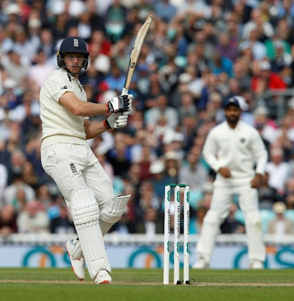Jos Buttler smashes a six during England's first innings in the fifth Test against India