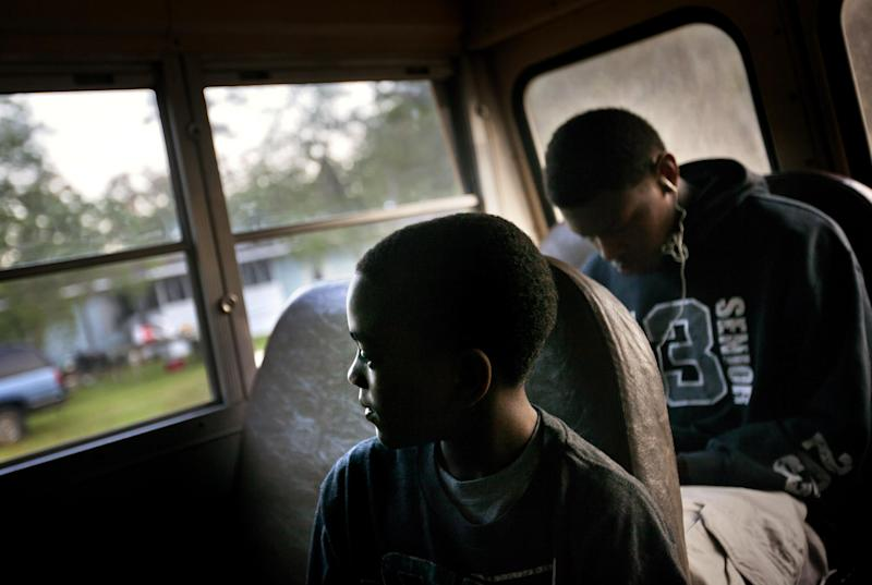 J.J. Wilson 9, rides a school bus to catch a ferry to the his school on the mainland from his home in the Hog Hammock community of Sapelo Island, Ga. on Wednesday, May 15, 2013. Eight children catch a ferry in the morning to attend school on the mainland since the last school operating on the island closed in 1978. (AP Photo/David Goldman)