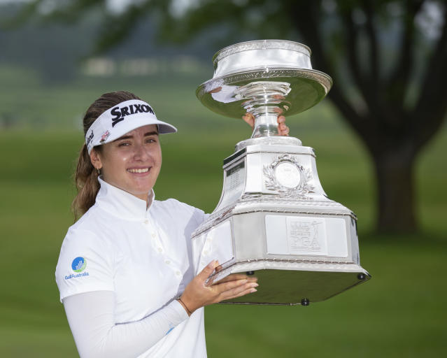 Hannah Green, of Australia, holds the trophy after winning the KPMG Women's PGA Championship golf tournament, Sunday, June 23, 2019, in Chaska, Minn. (AP Photo/Andy Clayton-King)