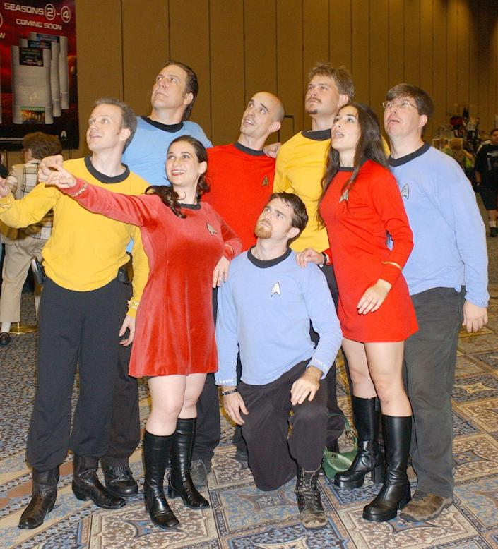 """<p>Got a big group that isn't looking to spend much money? Then get yourselves some plain yellow, blue, and red shirts layered over black and you can transform yourself into a<em> Star Trek </em>crew. </p><p><a class=""""link rapid-noclick-resp"""" href=""""https://www.amazon.com/Star-Original-Costume-Sleeve-Shirt/dp/B08G67WPC2?tag=syn-yahoo-20&ascsubtag=%5Bartid%7C10070.g.3083%5Bsrc%7Cyahoo-us"""" rel=""""nofollow noopener"""" target=""""_blank"""" data-ylk=""""slk:SHOP STAR TREK SHIRTS"""">SHOP STAR TREK SHIRTS</a></p>"""
