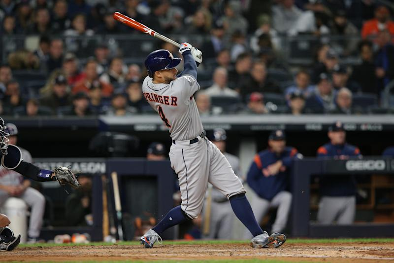 Oct 17, 2019; Bronx, NY, USA; Houston Astros center fielder George Springer (4) hits a three run home run during the third inning against the New York Yankees in game four of the 2019 ALCS playoff baseball series at Yankee Stadium. Mandatory Credit: Brad Penner-USA TODAY Sports