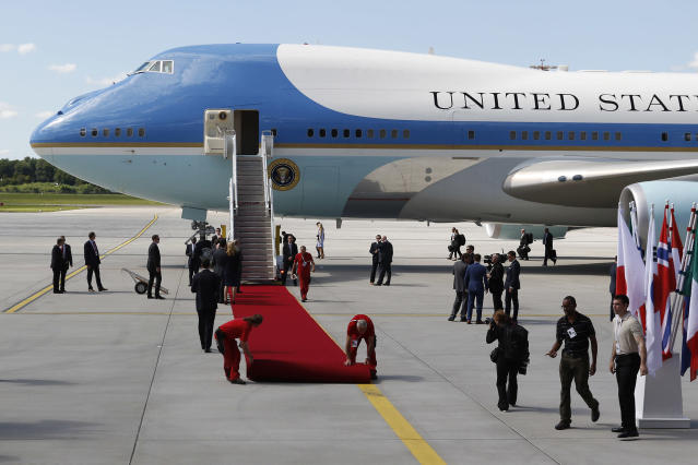 <p>Ramp workers unroll a red carpet as President Donald J. Trump and the first lady Melania Trump arrive at Hamburg Airport for the Hamburg G20 economic summit (Photo: Morris MacMatzen/Getty Images) </p>