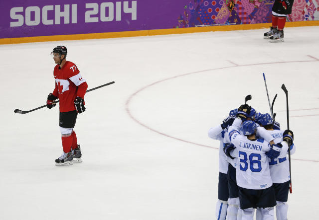 Canada forward Jeff Carter, left, skates down the ice after team Finland scored a goal in the second period of a men's ice hockey game at the 2014 Winter Olympics, Sunday, Feb. 16, 2014, in Sochi, Russia. (AP Photo/Julio Cortez)