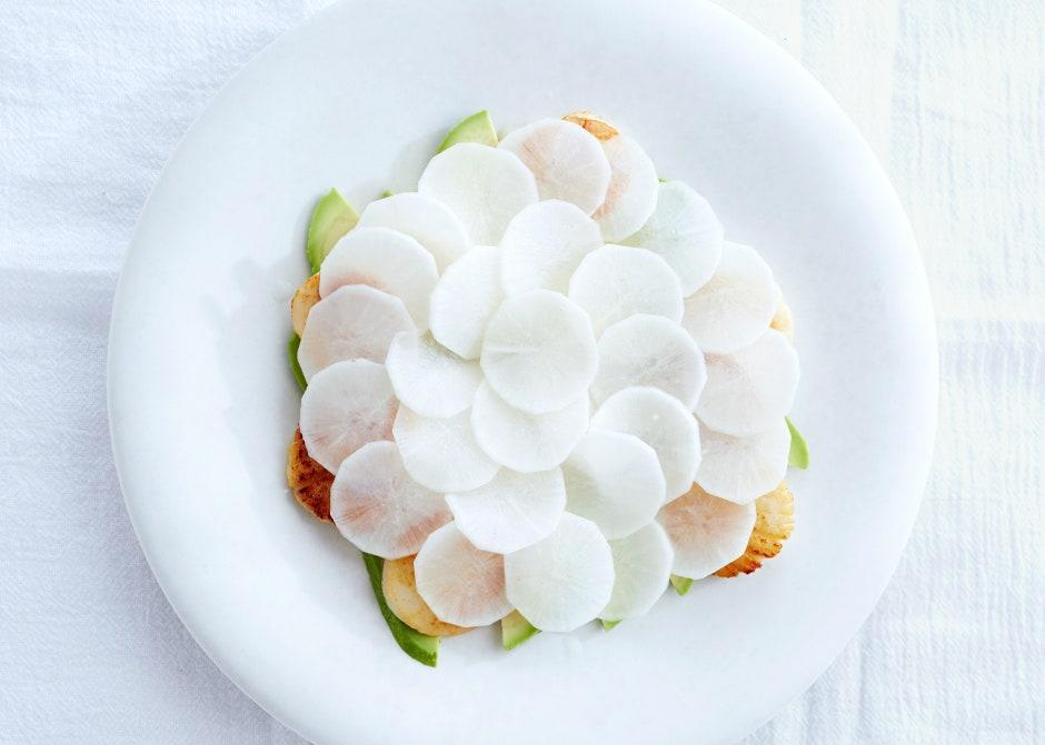 """Make this salad without plating anxiety: Treat the daikon rounds like a deck of cards and let them fall where they may. <a href=""""https://www.bonappetit.com/recipe/seared-scallops-with-avocado-and-daikon?mbid=synd_yahoo_rss"""" rel=""""nofollow noopener"""" target=""""_blank"""" data-ylk=""""slk:See recipe."""" class=""""link rapid-noclick-resp"""">See recipe.</a>"""