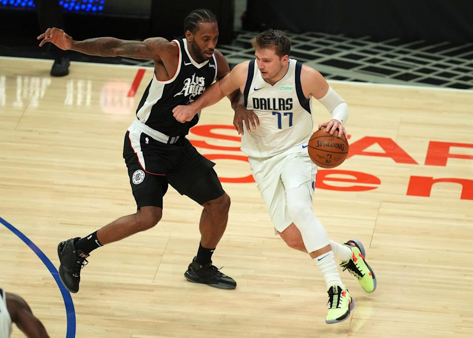 Dallas Mavericks guard Luka Doncic moves to the basket against Los Angeles Clippers forward Kawhi Leonard during Game 7 of their Western Conference first-round playoff series at Staples Center on June 6, 2021. (Kirby Lee/USA TODAY Sports)