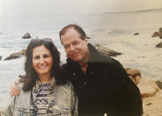 Associated Press journalist Sharon Cohen and her partner, Mike Robinson, pose for a photo on the California coast in this undated photo. Cohen, a matchless reporter who told American stories with great skill and compassion over more than four decades at The AP, died Monday, April 5, 2021, at her Chicago home. She was 68. (Courtesy of Mike Robinson)